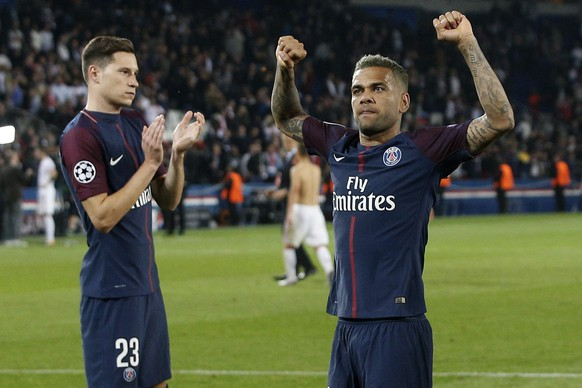 PSG's Dani Alves, right, celebrates besides teammate Julian Draxler after the Champions League Group B soccer match between Paris Saint-Germain and Bayern Munich in Paris, France, Wednesday, Sept. 27, 2017. (AP Photo/Thibault Camus)