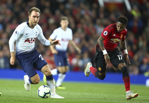 Tottenham Hotspur's Christian Eriksen, left, runs clear from Manchester United's Fred during the English Premier League soccer match between Manchester United and Tottenham Hotspur at Old Trafford stadium in Manchester, England, Monday, Aug. 27, 2018. (AP Photo/Dave Thompson)