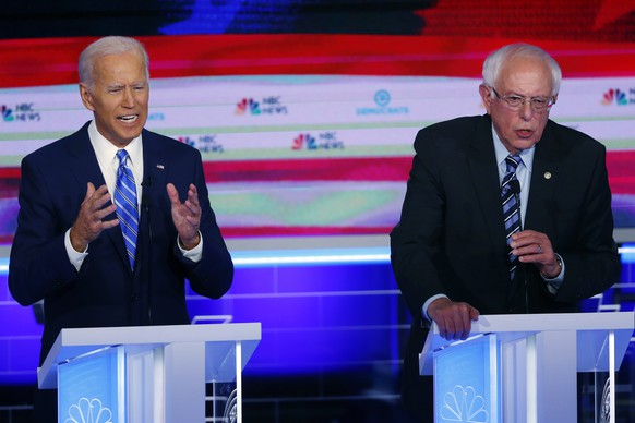 FILE - In this June 27, 2019, file photo, Democratic presidential candidates, former Vice President Joe Biden and Sen. Bernie Sanders, I-Vt., speak at the same time during the Democratic primary debate hosted by NBC News at the Adrienne Arsht Center for the Performing Arts in Miami. What might be the final showdown between the two very different Democratic candidates takes place Tuesday, March 17, 2020, during Florida's presidential primary. (AP Photo/Wilfredo Lee, File)