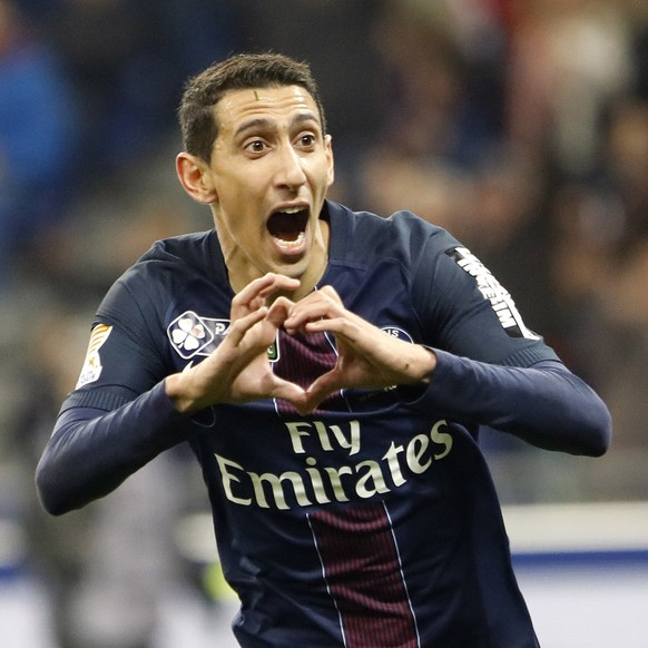 FILE - In this April 1, 2017, file photo, Paris Saint Germain's Angel Di Maria celebrates after he scored a goal against Monaco during their League Cup final soccer match in Decines, France. A French official says police investigating suspected tax fraud linked to the soccer industry have raided the headquarters of Paris Saint-Germain and the homes of three Argentine players in France. The official said anti-corruption police units searched the homes of PSG players Angel Di Maria and Javier Pastore, and that of Nantes forward Emiliano Sala on Tuesday, May 23, 2017. (AP Photo/Laurent Cipriani, File)