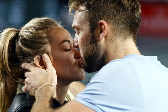 Jack Sock of the United States kisses his girl friend as he celebrates his victory against Filip Krajinovic of Serbia during their final match of the Paris Masters tennis tournament at the Bercy Arena in Paris, France, Sunday, Nov. 5, 2017. (AP Photo/Francois Mori)
