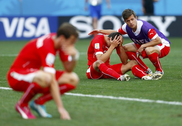 Switzerland players react after extra time in the 2014 World Cup round of 16 game between Argentina and Switzerland at the Corinthians arena in Sao Paulo July 1, 2014. REUTERS/Eddie Keogh (BRAZIL  - Tags: SOCCER SPORT WORLD CUP)