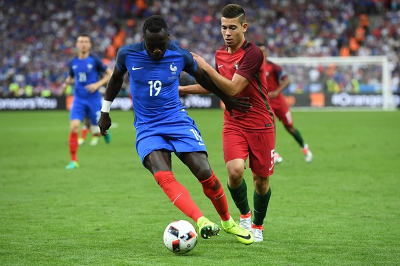 epa05419401 Bacary Sagna (L) of Francein action against Raphael Guerreiro of Portugal  during the UEFA EURO 2016 Final match between Portugal and France at Stade de France in Saint-Denis, France, 10 July 2016.(RESTRICTIONS APPLY: For editorial news reporting purposes only. Not used for commercial or marketing purposes without prior written approval of UEFA. Images must appear as still images and must not emulate match action video footage. Photographs published in online publications (whether via the Internet or otherwise) shall have an interval of at least 20 seconds between the posting.)  EPA/GEORGI LICOVSKI   EDITORIAL USE ONLY
