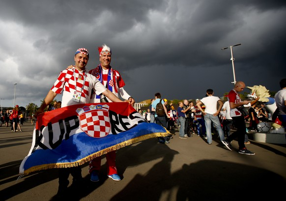 Croatia fans arrive for the semifinal match between Croatia and England at the 2018 soccer World Cup in the Luzhniki Stadium in Moscow, Russia, Wednesday, July 11, 2018. (AP Photo/Rebecca Blackwell)