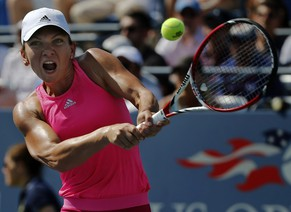 Simona Halep, of Romania, returns a shot against Jana Cepelova, of Slovakia, during the second round of the 2014 U.S. Open tennis tournament, Wednesday, Aug. 27, 2014, in New York. (AP Photo/Elise Amendola)
