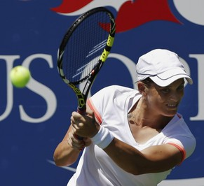 Romina Oprandi, of Swizterland, returns a shot against Daniela Hantuchova, of Slovakia, of the United States, during the opening round of the 2014 U.S. Open tennis tournament, Monday, Aug. 25, 2014, in New York. (AP Photo/Frank Franklin II)