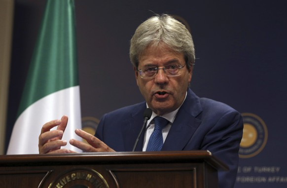 FILE - In this Thursday, Oct. 6, 2016 file photo, Italian Foreign Minister Paolo Gentiloni talks during a joint press conference with Turkish foreign Minister Mevlut Cavusoglu, in Ankara. Italy's Foreign Minister Paolo Gentiloni has been summoned to the presidential palace to see the president Sunday, Dec. 11, 2016, who could ask him to be premier and try to form a government. (AP Photo/Burhan Ozbilici, File)