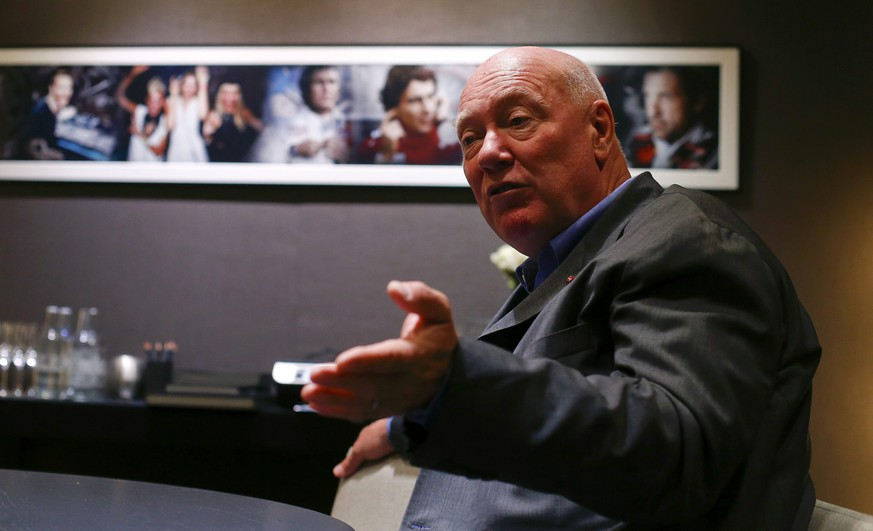 Jean-Claude Biver, head of French luxury goods group LVMH's watch business and interim CEO of the group's biggest watch brand, TAG Heuer gestures during an interview with Reuters at Baselworld fair in Basel March 18, 2015. TAG Heuer said on Wednesday it plans to cut prices by between 7 percent and 13 percent in some markets following the recent appreciation of the Swiss franc. The world's leading watch and jewellery show Baselworld is to be held in Basel from March 19 to 26, 2015. REUTERS/Arnd Wiegmann (SWITZERLAND - Tags: BUSINESS SOCIETY)