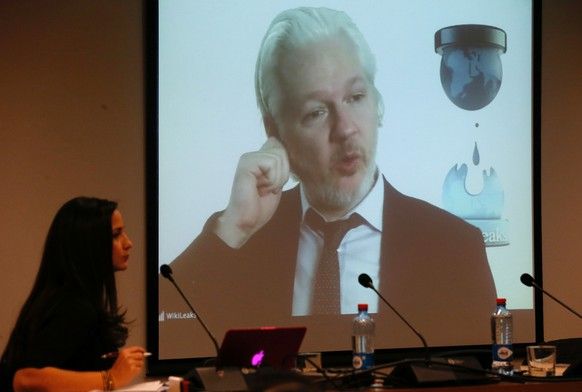 WikiLeaks founder Julian Assange appears on screen via video link  during his participation as a guest panelist in an International Seminar on the 60th anniversary of the college of Journalists of Chile in Santiago, Chile, July 12, 2016.  REUTERS/Rodrigo Garrido
