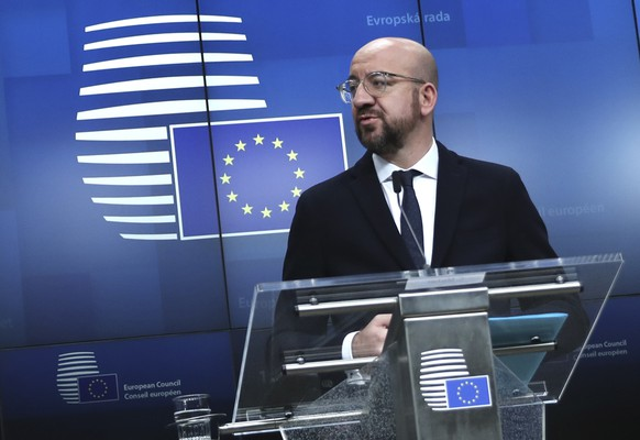 FILE - In this file photo dated Friday, Dec. 13, 2019, European Council President Charles Michel during a media conference at the conclusion of an EU summit in Brussels.  Massive challenges lay ahead for the European Union in 2020, as the impact of climate change seems likely to drive the bloc's thinking and policy initiatives over the coming years, starting Wednesday Jan. 1, 2020. (AP Photo/Francisco Seco, FILE)