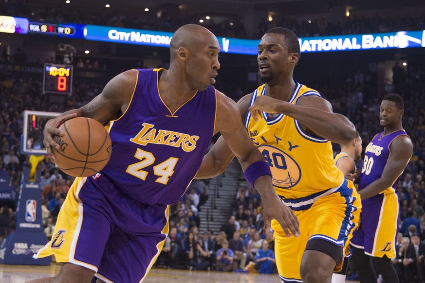 November 24, 2015; Oakland, CA, USA; Los Angeles Lakers forward Kobe Bryant (24) dribbles the basketball against Golden State Warriors forward Harrison Barnes (40) during the first quarter at Oracle Arena. Mandatory Credit: Kyle Terada-USA TODAY Sports