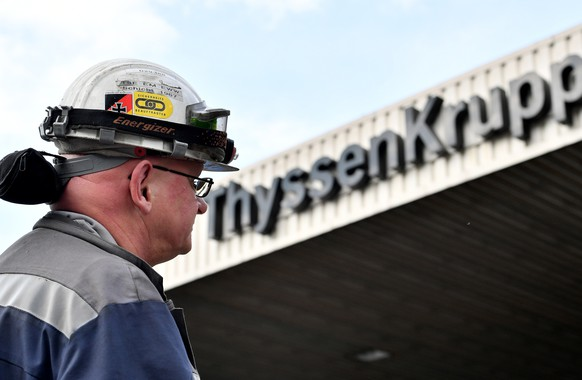 epa07560448 (FILE) - A steel worker stands in front of Gate 1 of the headquarters of German steel maker ThyssenKrupp Steel Europe in Duisburg, Germany, 20 September 2017 (reissued 10 May 2019). Reports on 10 May 2019 state ThyssenKrupp chairman of the board Guido Kerkhoff saying the company plans to cut some 6,000 jobs globally as it expects the planned merger with Tata Steel from India not to take place. Some 4,000 jobs of the 6,000 are to be lost in Germany.  EPA/SASCHA STEINBACH