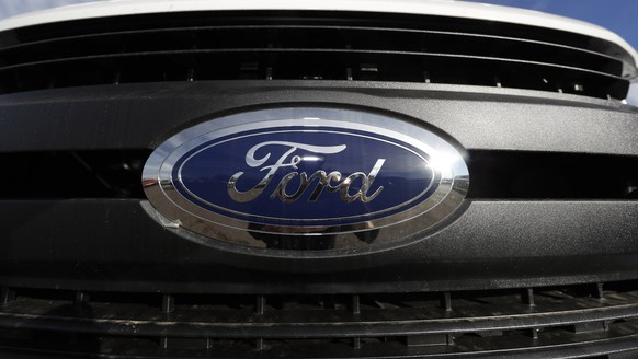 FILE - In this Nov. 10, 2019, file photograph, the company logo shines off the grille of an unsold F-350 pickup truck at a Ford dealership in Littleton, Colo. Ford Motor Co. is recalling nearly 262,000 heavy-duty pickup trucks in the U.S. and Canada because the tailgates can open unexpectedly. The recall covers F-250, F-350 and F-450 trucks from the 2017 through 2019 model years. All the trucks have electric tailgate latch release switches in the tailgate handle. (AP Photo/David Zalubowski, File)2020 Ford F-350,r m