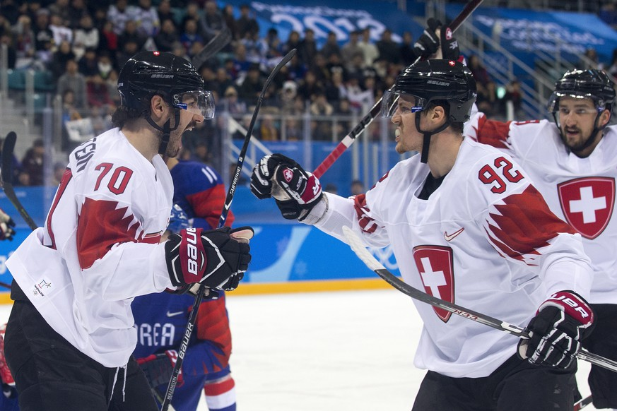 Denis Hollenstein of Switzerland,, Gaetan Haas of Switzerland, and Vincent Praplan of Switzerland, from left, celebrate during the men ice hockey preliminary round match between South Korea and Switzerland in the Gangneung Hockey Center in Gangneung during the XXIII Winter Olympics 2018 in Pyeongchang, South Korea, on Saturday, February 17, 2018. (KEYSTONE/Alexandra Wey)