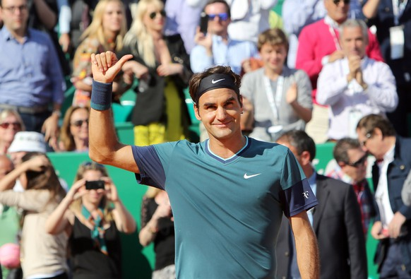 Roger Federer of Switzerland acknowledges applause after defeating Novak Djokovic of Serbia, in their semifinal match of the Monte Carlo Tennis Masters tournament, in Monaco, Saturday, April, 19, 2014. Fedrere won 7-6, 6-2. (AP Photo/Claude Paris)