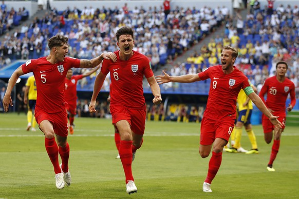 England's Harry Maguire, center, celebrates with his team mates after scoring his side opening goal during the quarterfinal match between Sweden and England at the 2018 soccer World Cup in the Samara Arena, in Samara, Russia, Saturday, July 7, 2018. (AP Photo/Francisco Seco)