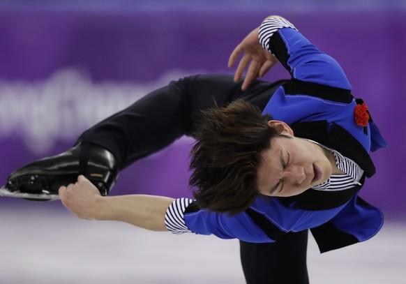 Keiji Tanaka of Japan performs during the men's free figure skating final in the Gangneung Ice Arena at the 2018 Winter Olympics in Gangneung, South Korea, Saturday, Feb. 17, 2018. (AP Photo/Bernat Armangue)