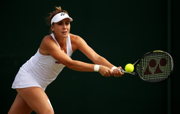 LONDON, ENGLAND - JULY 06:  Belinda Bencic of Switzerland plays backhand in her Ladies' Singles Fourth Round match against Victoria Azarenka of Belarus during day seven of the Wimbledon Lawn Tennis Championships at the All England Lawn Tennis and Croquet Club on July 6, 2015 in London, England.  (Photo by Ian Walton/Getty Images)
