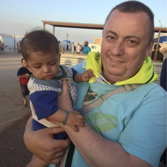An undated family handout photo of British aid worker Alan Henning taken at a refugee camp on the Turkish-Syria border.  Islamic State militants fighting in Iraq and Syria released a video on September 13, 2014 that purported to show the beheading of British aid worker David Haines. At the end of the video, another hostage, identified as Alan Henning, was shown and the masked man said he would be killed if Britain's Prime Minister David Cameron continued to support the fight against Islamic State.  REUTERS/Henning family handout via the British Foreign and Commonwealth Office/Handout via Reuters (CIVIL UNREST TPX IMAGES OF THE DAY)  ATTENTION EDITORS - THIS PICTURE WAS PROVIDED BY A THIRD PARTY. REUTERS IS UNABLE TO INDEPENDENTLY VERIFY THE AUTHENTICITY, CONTENT, LOCATION OR DATE OF THIS IMAGE. FOR EDITORIAL USE ONLY. NOT FOR SALE FOR MARKETING OR ADVERTISING CAMPAIGNS. NO SALES. NO ARCHIVES