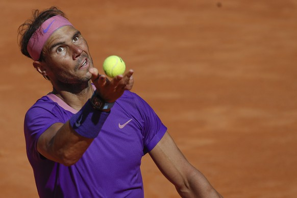 Spain's Rafael Nadal looks serves the ball to Canada's Denis Shapovalov, during their 3rd round match at the Italian Open tennis tournament, in Rome, Thursday, May 13, 2021. (AP Photo/Alessandra Tarantino)