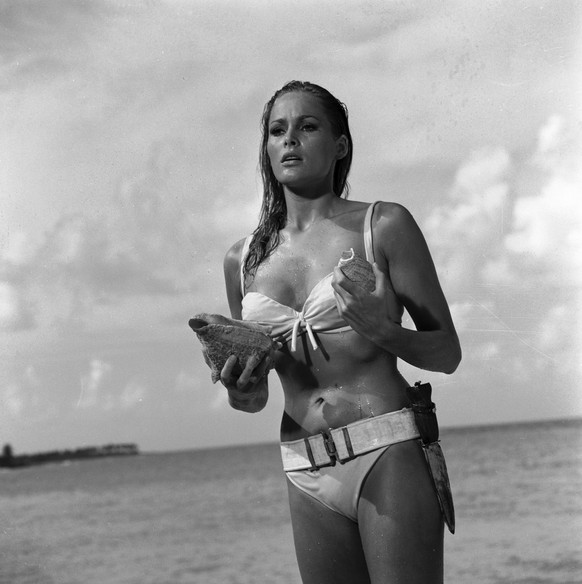 """This undated publicity photo provided by United Artists and Danjaq, LLC shows Ursula Andress in a scene from the James Bond 1962 film, """"Dr. No."""" When Ursula Andress emerged from the sea, curves glistening, with a dagger strapped to her bikini in 1962's """"Dr. No"""" she made the Bond girl an instant icon. The film is included in the MGM and 20th Century Fox Home Entertainment Blu-Ray """"Bond 50"""" anniversary set. (KEYSTONE/AP Photo/United Artists and Danjaq, LLC)"""
