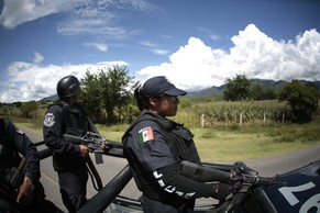 Police officers patrol the road to Huitzuco during a search for missing students in Iguala, in the outskirts of the village of Tepecoacuilco southwestern town in the Mexican state of Guerrero, October 3, 2014. Authorities on Friday were still searching for the 43 students of the Ayotzinapa teacher training college who have been missing since September 26 following a series of clashes involving students, police, and armed men in the southwestern town of Iguala. Guerrero State Governor Angel Aguirre has offered a reward of one million Mexican pesos, ($74,000) for information leading to the whereabouts of the kidnapped people. 