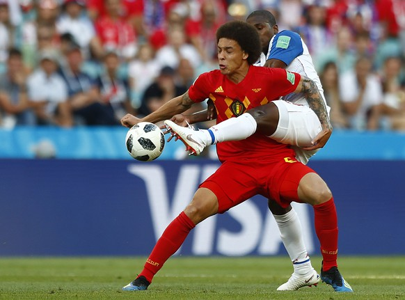 Belgium's Axel Witsel, left, and Panama's Armando Cooper challenge for the ball during the group G match between Belgium and Panama at the 2018 soccer World Cup in the Fisht Stadium in Sochi, Russia, Monday, June 18, 2018. (AP Photo/Matthias Schrader)