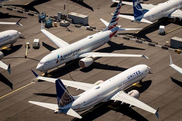 epa08968609 (FILE) - Boeing 737 Max 8 aircraft owned by American Airlines and United Airlines sit parked at Boeing Field in Seattle, Washington, USA, 21 July 2019 (reissued 27 January 2021). Media reports on 27 January 2021 state European Union Aviation Safety Agency (Easa) has stated Boeing's 737 Max planes can restart their flight operations in Europe. The return to service follows a 22-month ban on Boeing 737 Max flights, imposed by EASA following two crashes of Boeing 737 Max planes which caused 346 people to be killed.  EPA/GARY HE   EDITORIAL USE ONLY *** Local Caption *** 55353865