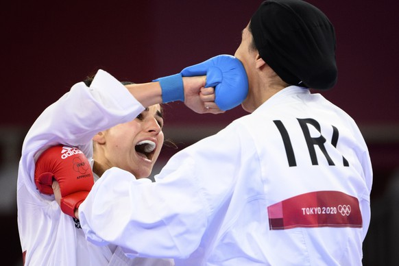 epa09402803 Elena Quirici, (L) of Switzerland competes in the women's karate kumite +61kg fight against Hamideh Abbasali of the Islamic Republic of Iran at the 2020 Tokyo Summer Olympics in Tokyo, Japan, 07 August 2021.  EPA/LAURENT GILLIERON