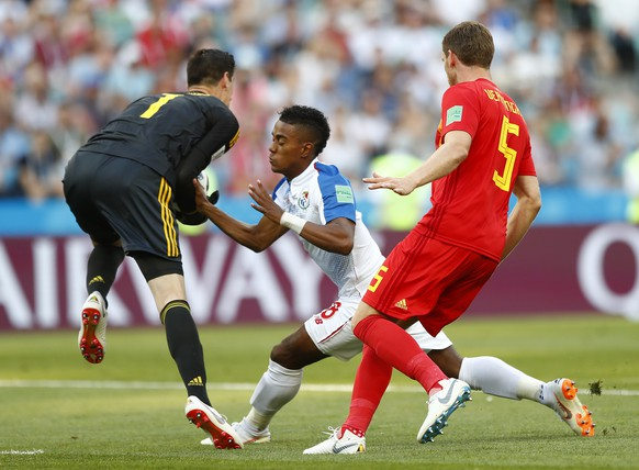 Belgium goalkeeper Thibaut Courtois saves the ball in front of Panama's Edgar Barcenas during the group G match between Belgium and Panama at the 2018 soccer World Cup in the Fisht Stadium in Sochi, Russia, Monday, June 18, 2018. (AP Photo/Matthias Schrader)