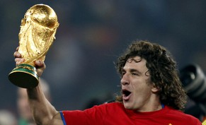 Spain's Carles Puyol holds the World cup trophy after  the World Cup final soccer match between the Netherlands and Spain at Soccer City in Johannesburg, South Africa, Sunday, July 11, 2010.  Spain won 1-0. (AP Photo/Luca Bruno)