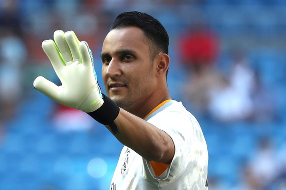 epa07813234 (FILE) Real Madrid's goalkeeper Keylor Navas warms up before the Spanish LaLiga match between Real Madrid and Real Valladolid at Santiago Bernabeu stadium in Madrid, Spain, 24 August 2019 (reissued 02 September 2019). Real Madrid has transfered Costa Rican goalkeeper Keylor Navas to Paris Saint-Germain on 02 September 2019.  EPA/Kiko Huesca
