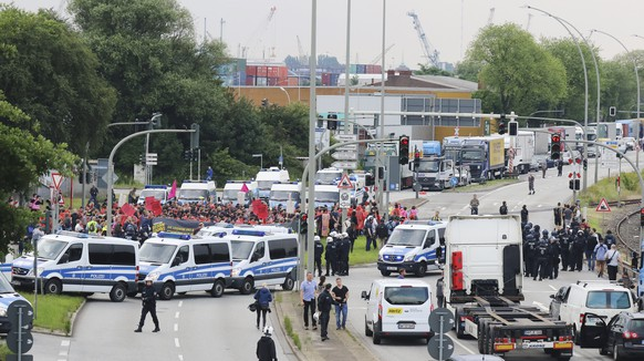 epa06071923 Protesters attend a demonstration at the Hamburg Harbour during the opening of the G20 summit in Hamburg, Germany, 07 July 2017. The G20 Summit (or G-20 or Group of Twenty) is an international forum for governments from 20 major economies. The summit is taking place in Hamburg from 07 to 08 July 2017.  EPA/FOCKE STRANGMANN  EPA/FOCKE STRANGMANN