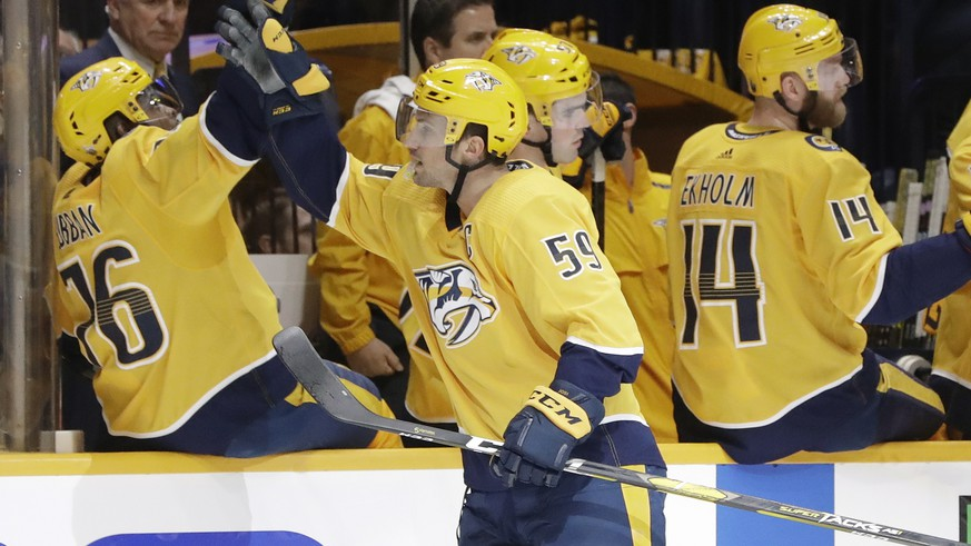 Nashville Predators defenseman Roman Josi (59), of Switzerland, celebrates with P.K. Subban (76) after Josi scored a goal against the Dallas Stars during the first period in Game 1 of an NHL hockey first-round playoff series Wednesday, April 10, 2019, in Nashville, Tenn. (AP Photo/Mark Humphrey)