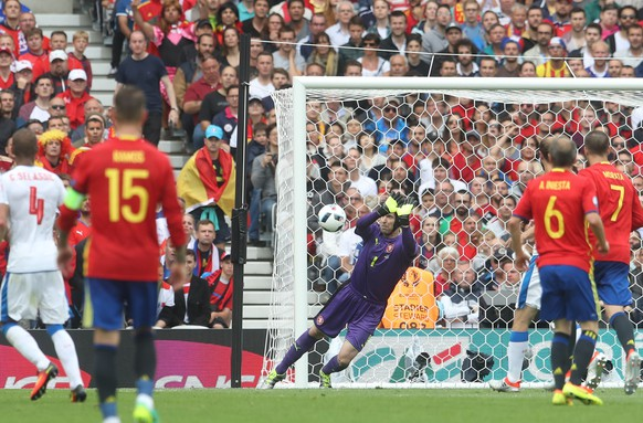 Czech Republic goalkeeper Petr Cech, center, dives to make a save during the Euro 2016 Group D soccer match between Spain and the Czech Republic at the Stadium municipal in Toulouse, France, Monday, June 13, 2016. (AP Photo/Petr David Josek)