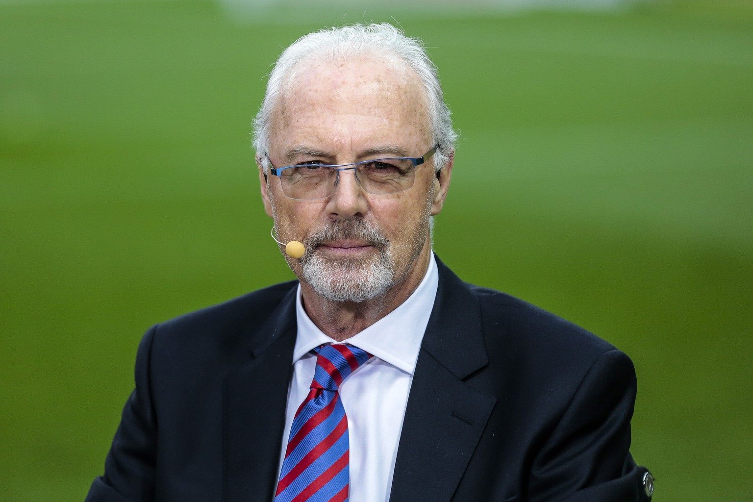 FILE - The May 17, 2014 photo shows German soccer legend Franz Beckenbauer attending a television show prior to the German Soccer Cup Final between  Bayern Munich and Borussia Dortmund  in  Berlin. FIFA has lifted Franz Beckenbauer's ban from all football-related activity for failing to help an investigation of alleged corruption in the 2018 and 2022 World Cup votes, the German great's manager said on Friday June 27, 2014. Football's governing body informed Beckenbauer on Friday that the ban was lifted with immediate effect, manager Marcus Hoefl said in a statement posted via his Twitter feed.  (AP Photo/Markus Schreiber)