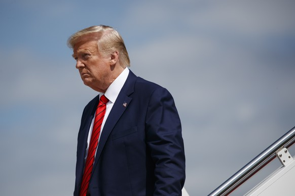 "FILE - In this Thursday, Sept. 26, 2019 file photo, President Donald Trump steps off Air Force One after arriving at Andrews Air Force Base, Md. The BBC is facing a backlash after finding one of its presenters in breach of its editorial guidelines on impartiality for comments that were critical of U.S. President Donald Trump. Journalists and celebrities are demanding the BBC overturn its decision, expressing support for BBC Breakfast anchor Naga Munchetty, who was discussing Trump's remark on July 17 that four female American lawmakers should return to the ""broken and crime infested places from which they came.'' (AP Photo/Evan Vucci, file) Donald Trump"