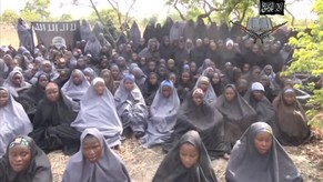 Kidnapped schoolgirls are seen at an unknown location in this still image taken from an undated video released by Nigerian Islamist rebel group Boko Haram. The leader of the Nigerian Islamist rebel group Boko Haram has offered to release more than 200 schoolgirls abducted by his fighters last month in exchange for prisoners, according to a video seen on YouTube. About 100 girls wearing full veils and praying are shown in an undisclosed location in the 17-minute video in which Boko Haram leader Abubakar Shekau speaks. MANDATORY CREDIT. REUTERS/Boko Haram handout via Reuters TV (CONFLICT POLITICS CRIME LAW) ATTENTION EDITORS - THIS PICTURE WAS PROVIDED BY A THIRD PARTY. REUTERS IS UNABLE TO INDEPENDENTLY VERIFY THE AUTHENTICITY, CONTENT, LOCATION OR DATE OF THIS IMAGE. FOR EDITORIAL USE ONLY. NOT FOR SALE FOR MARKETING OR ADVERTISING CAMPAIGNS. NO SALES. NO ARCHIVES. THIS PICTURE IS DISTRIBUTED EXACTLY AS RECEIVED BY REUTERS, AS A SERVICE TO CLIENTS. MANDATORY CREDIT. NO COMMERCIAL USE