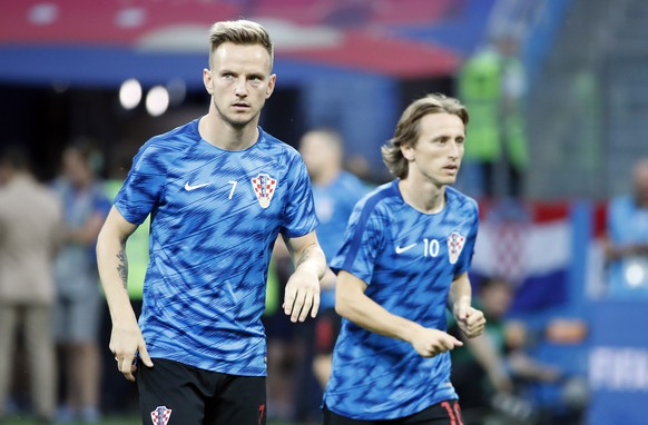 epa06855978 Ivan Rakitic of Croatia (L) and Luka Modric of Croatia warm up prior the FIFA World Cup 2018 round of 16 soccer match between Croatia and Denmark in Nizhny Novgorod, Russia, 01 July 2018.  (RESTRICTIONS APPLY: Editorial Use Only, not used in association with any commercial entity - Images must not be used in any form of alert service or push service of any kind including via mobile alert services, downloads to mobile devices or MMS messaging - Images must appear as still images and must not emulate match action video footage - No alteration is made to, and no text or image is superimposed over, any published image which: (a) intentionally obscures or removes a sponsor identification image; or (b) adds or overlays the commercial identification of any third party which is not officially associated with the FIFA World Cup)  EPA/FRANCK ROBICHON   EDITORIAL USE ONLY
