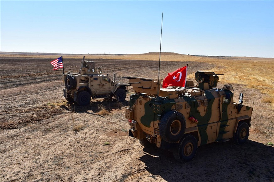 epa07903524 (FILE) - A handout photo made available by Turkey's National Defense Ministry shows Turkish and US army vehicles in Tal Abyad (Tell Abyad) city, at the Turkey-Syria border in northeastern Syria, 08 September 2019 (reissued 07 October 2019). Media reports state on 07 October 2019 that US troops began withdrawing ahead of a possible Turkish operation in northeast Syria.  EPA/TURKEY'S NATIONAL DEFENSE MINISTRY HANDOUT BEST QUALITY AVAILABLE HANDOUT EDITORIAL USE ONLY/NO SALES