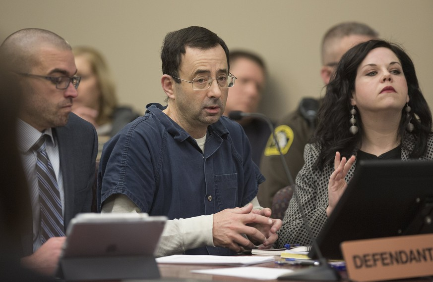 epa06444084 Dr. Larry Nassar appears during court proceedings in the sentencing phase in Lansing, Michigan, USA, 16 January 2018. Nassar was a doctor at Michigan State University and for the US Gymnastics team and has been convicted on multiple counts of sexual abuse of minors and faces additional sentencing in Michigan.  EPA/RENA LAVERTY