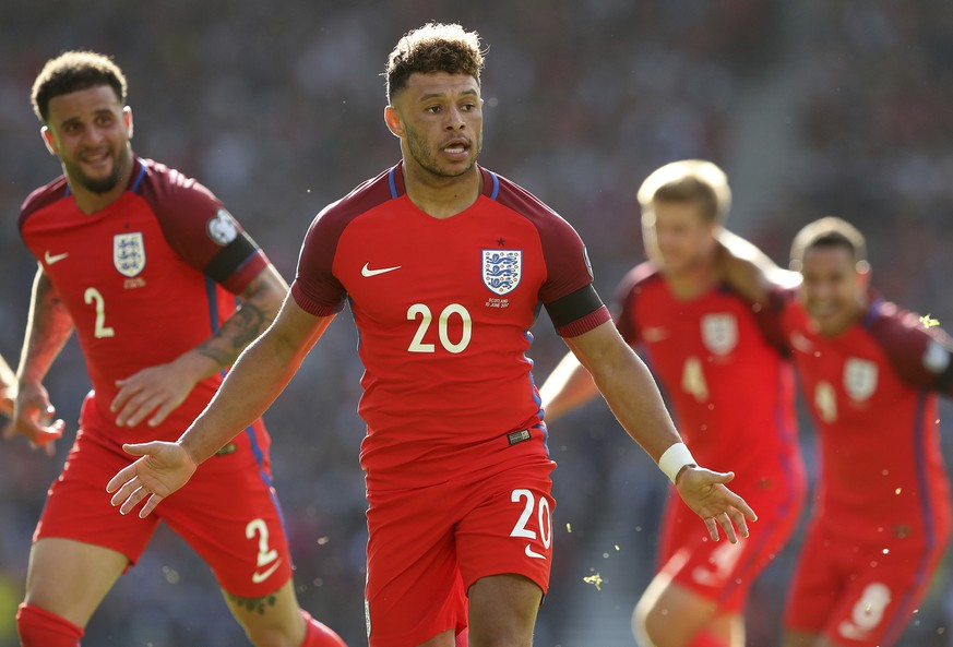 England's Alex Oxlade-Chamberlain, center, celebrates his goal during the World Cup Group F qualifying soccer match between Scotland and England at Hampden Park, Glasgow, Scotland, Saturday, June 10, 2017. (AP Photo/Scott Heppell)