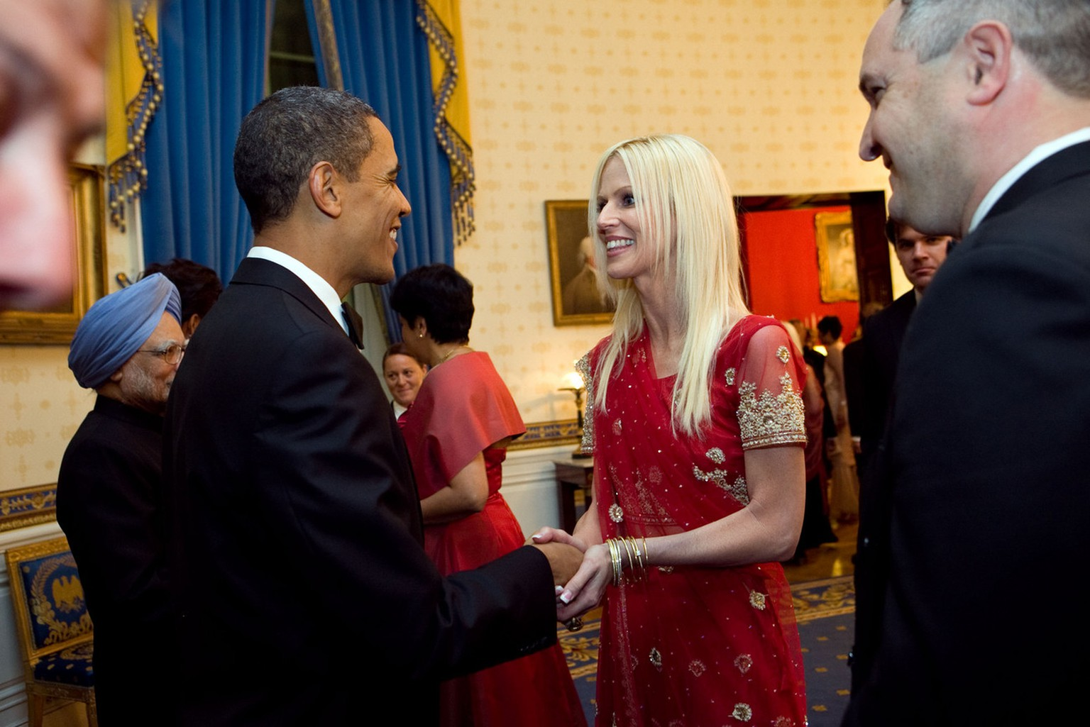 This photo released by the White House Nov. 27, 2009, shows President Barack Obama greeting  Michaele and Tareq Salahi, right, at a State Dinner hosted by Obama for Indian Prime Minister Manmohan Singh at the White House in Washington Tuesday, Nov. 24, 2009.  The Secret Service is looking into its own security procedures after determining that the uninvited Virginia couple managed to slip into the dinner. (AP Photo/The White House, Samantha Appleton)