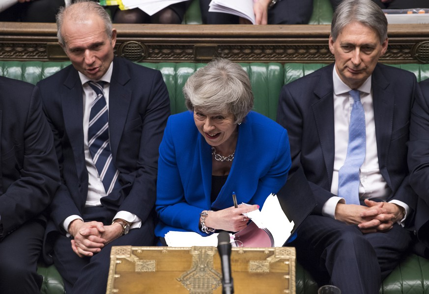 Britain's Prime Minister Theresa May reacts during a debate before a no-confidence vote raised by opposition Labour Party leader Jeremy Corbyn, in the House of Commons, London, Wednesday Jan. 16, 2019.  Prime Minister May has won a no confidence vote Wednesday. (Mark Duffy, UK Parliament via AP)