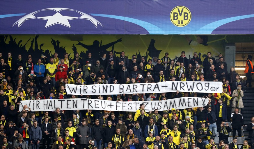 epa05904700 Borussia's supporters hold a banner reading 'We are Bartra, We stand together' prior to the UEFA Champions League quarter final, first leg soccer match between Borussia Dortmund and AS Monaco at the Signal Iduna Park, in Dortmund, Germany, 12 April 2017.  EPA/FRIEDEMANN VOGEL