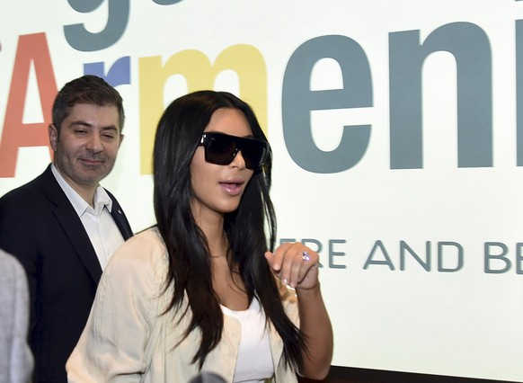 U.S. television personality Kim Kardashian walks shortly after her arrival in Yerevan, April 8, 2015. Picture taken April 8, 2015. REUTERS/Hayk Baghdasaryan/Photolure