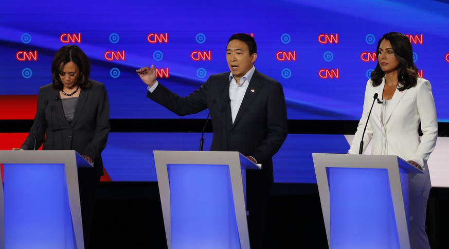 From left, Sen. Kamala Harris, D-Calif., Andrew Yang and Rep. Tulsi Gabbard, D-Hawaii, participate in the second of two Democratic presidential primary debates hosted by CNN Wednesday, July 31, 2019, in the Fox Theatre in Detroit. (AP Photo/Paul Sancya)