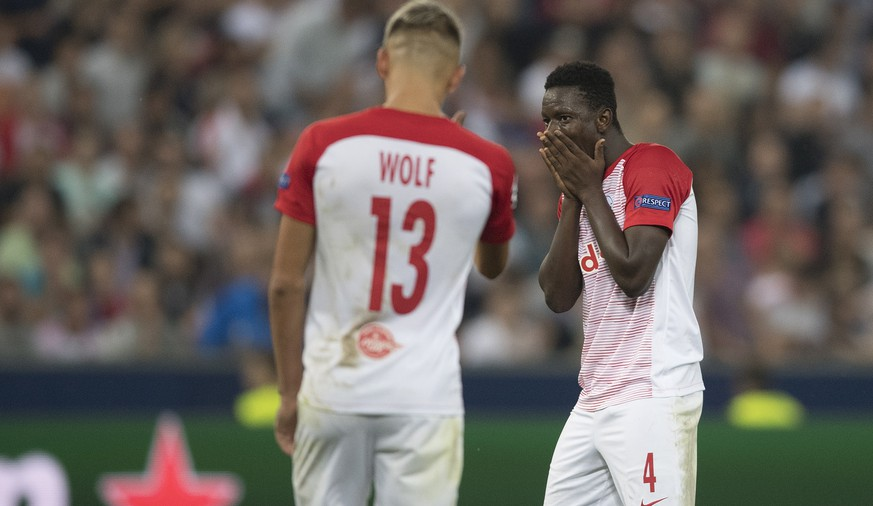 epa06982391 Salzburg's Hannes Wolf (L) and Amadou Haidara (R) react during the UEFA Champions League playoff second leg soccer match between FC Salzburg and FC Red Star Belgrade, in Salzburg, Austria, 29 August 2018.  EPA/ANDREAS SCHAAD