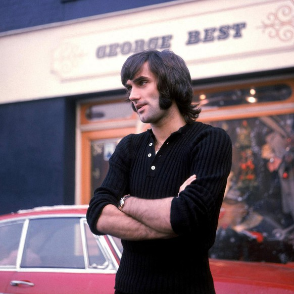 George Best the former Northern Ireland and Manchester United soccer star is seen in this January 1970 photo standing outside his store in Manchester, England.  Best who needed a liver transplant three years ago after decades of alcohol abuse, has been in critical condition at Cromwell Hospital in west London. George Best's condition has deteriorated and he is unlikely to survive another 24 hours, his doctor said Thursday, Nov. 24, 2005.