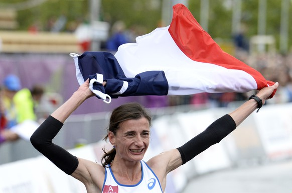 France's Christelle Daunay celebrates after winning the women's Marathon at the European Athletics Championships in Zurich on August 16, 2014.  AFP PHOTO /FRANCK FIFE